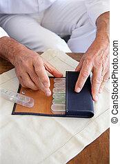 Woman preparing her medication