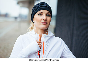 Woman preparing herself for a run