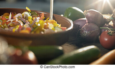 Woman preparing mixed vegetables in a bowl