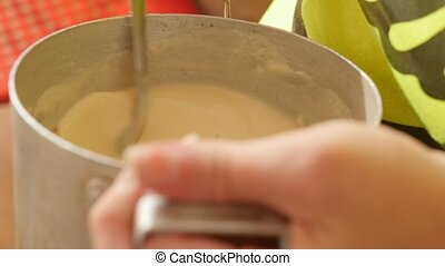 Woman preparing pancake mixing dough
