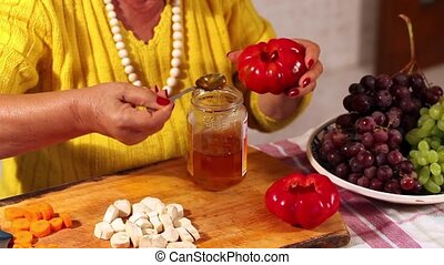 Woman Preparing Pickled Peppers - Senior woman preparing...