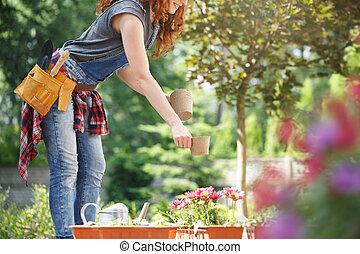 Woman preparing pots for planting