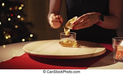 Woman preparing sauce from honey and mustard for christmas...
