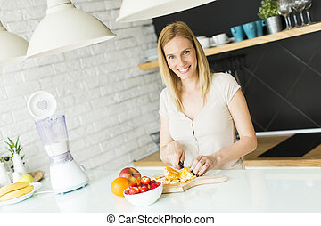 Woman preparing smoothie
