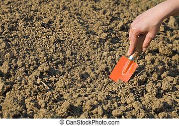 Woman preparing soil for spring gardening