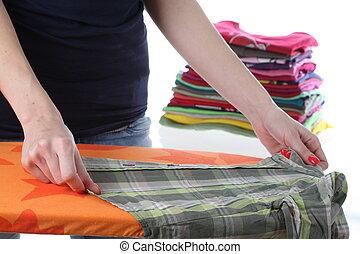 Woman preparing to ironing shirt