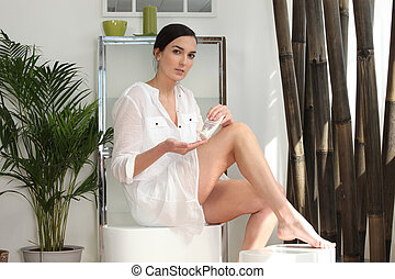 Woman preparing to shave her legs