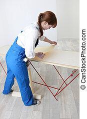 Woman preparing to wallpaper