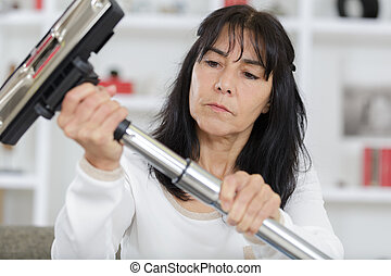 woman preparing vacuuming cleaner