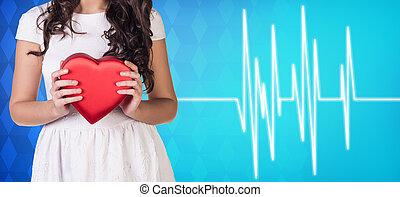 Woman present heartbox beside pulse line