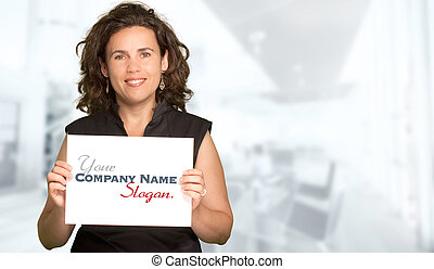 Woman presenting a blank sign in office background