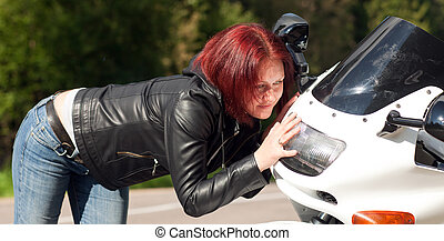 woman pressed against the motorcycle