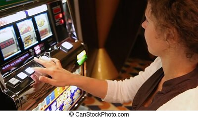 woman presses buttons of slot machine, loses and frowns close up