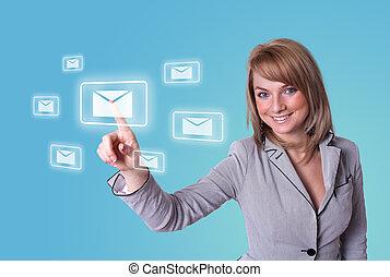 woman pressing e-mail icon