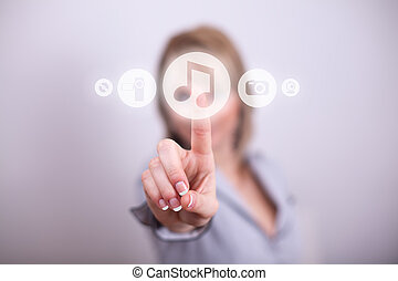 Woman pressing music media button