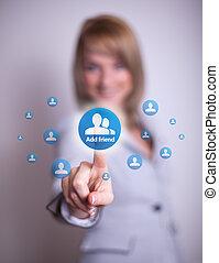 woman pressing social network icon - woman hand pressing...