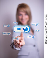 woman pressing social network icon - woman hand pressing...