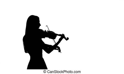 Woman professional violinist playing the fiddle. Silhouette...