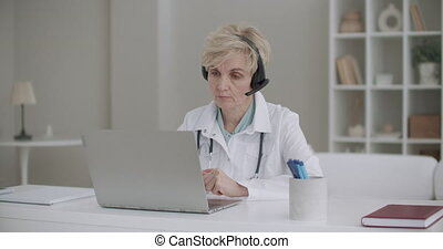 woman professor of medicine is lecturing online, teaching ...
