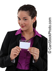 Woman proudly displaying visitors badge