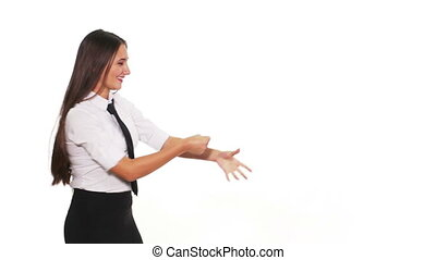 Woman pulling an imaginary string and presenting something