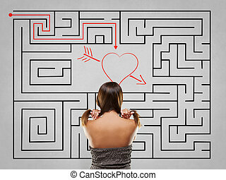 Woman pulling hair in front of labyrinth with love solution