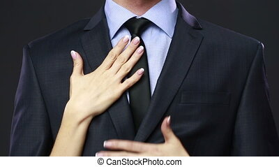 Woman pulls out money from a pocket of the businessman.
