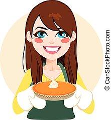 Woman Pumpkin Pie - Young brunette woman holding pumpkin pie...