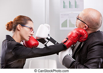 woman punching a man on the face in a box match