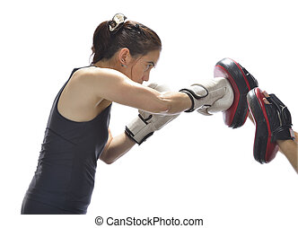 Woman punching boxing pads