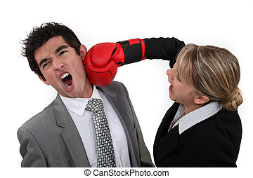Woman punching her colleague