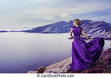 Woman Purple Dress Looking to Mountains Sea, Waving Gown Flying on Wind, Elegant Girl