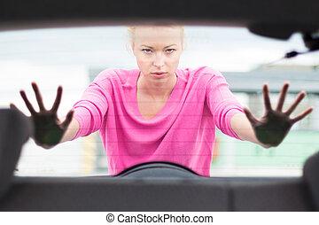 Woman pushing a car. - Self-sufficient, strong, young woman ...