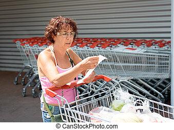 woman pushing a shopping caddy