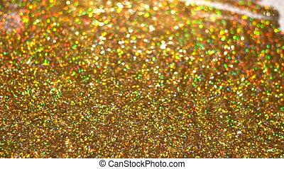 Woman put hands in golden glitter sparkles