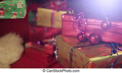 Woman puts a gift under christmas tree