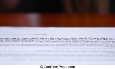 Woman puts a stamp on the document. Close up
