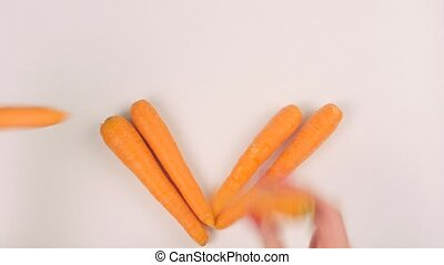 Woman puts carrots in the shape of a heart