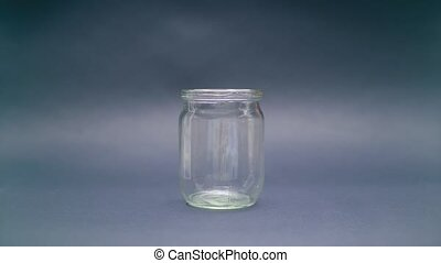Woman Puts Euro 500 into a Glass Jar