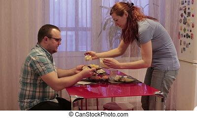 Woman puts man at the plate food