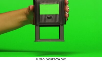 Woman puts print stamp on documents. Close up. Green screen...