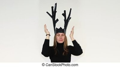 Woman putting a paper crown on her head - Beautiful young...