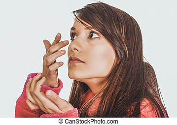 Woman putting contact lens in her eye.