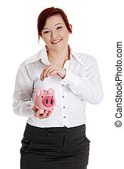 Woman putting euro coin in piggy bank.