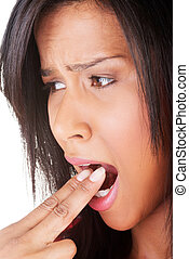 Woman putting her finger in her mouth to provoke vomiting.