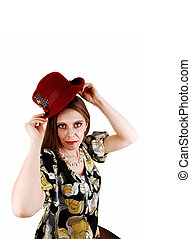 Woman putting her hat on.