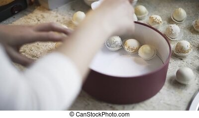 Woman putting homemade candy in a box