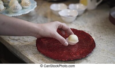 Woman putting homemade candy on a plate
