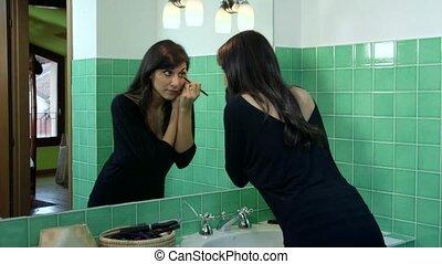 Woman Putting Make-up On Eyes