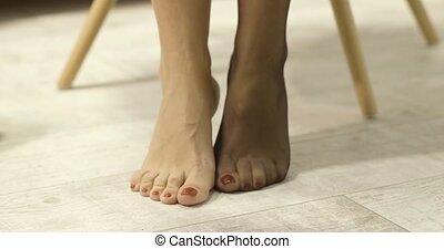 Woman putting nylon stockings - Woman putting on nylon brown...